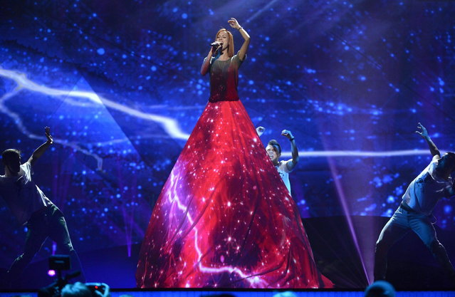 "Moldavian Aliona Moon performs the song ""O mie"" during the dress rehearsal for the final of the 2013 Eurovision Song Contest at the Malmo Arena Hall, May 17, 2013. (Photo by John MacDougall/AFP Photo)"