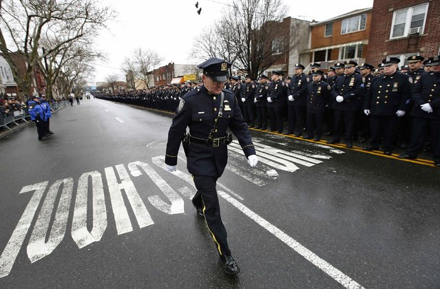 New York City police line the streets for the funeral service of New York Police Department officer Wenjian Liu in the Brooklyn borough of New York January 4, 2015. (Photo by Mike Segar/Reuters)