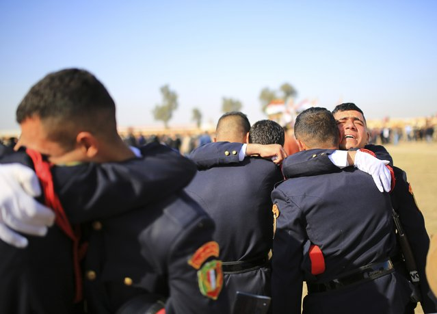 Iraqi officers react during their graduation ceremony during Iraqi Army Day anniversary celebration in Baghdad January 6, 2015. Iraqi Defence Minister Khaled al-Obeidi said on Tuesday that the Iraqi military has started rebuilding after its near total collapse last summer but that the effort is still in its initial phase. (Photo by Ahmad Mousa/Reuters)