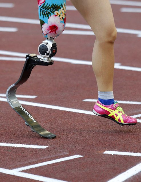 Hitomi Onishi of Japan prepares to start in the women's 100-meter Paralympic event at the Golden Gala IAAF Diamond League at the Olympic stadium in Rome, on June 6, 2013. (Photo by Reuters)