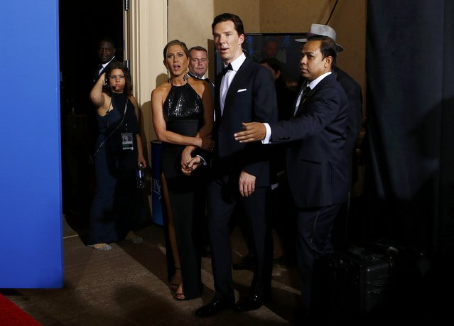 Presenters Benedict Cumberbatch and Jennifer Aniston enter the backstage area to pose for photos at the 72nd Golden Globe Awards in Beverly Hills, California January 11, 2015. (Photo by Mike Blake/Reuters)