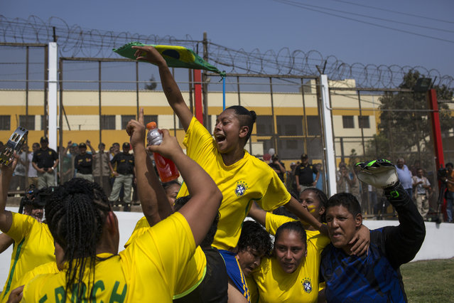 Inmates celebrate after winning a soccer match in the San Juan de Lurigancho prison, in Lima, Peru, Thursday, May 24, 2018. (Photoby Rodrigo Abd/AP Photo)