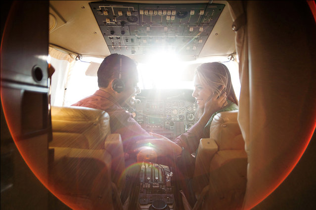 Bride and Groom pictured in an Aeroplane – 1st place – Family love. Boston, Massachusetts. (Photo by Masao Okano/Caters News)