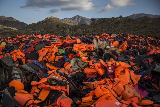 "Piles of life jackets used by refugees and migrants to cross the Aegean sea from the Turkish coast remain stacked on the northeastern Greek island of Lesbos, Wednesday, December 2, 2015. Greece's migration minister says his country has come under ""intense pressure"" from some European countries over the migration crisis, but he says that's unfair. (Photo by Santi Palacios/AP Photo)"