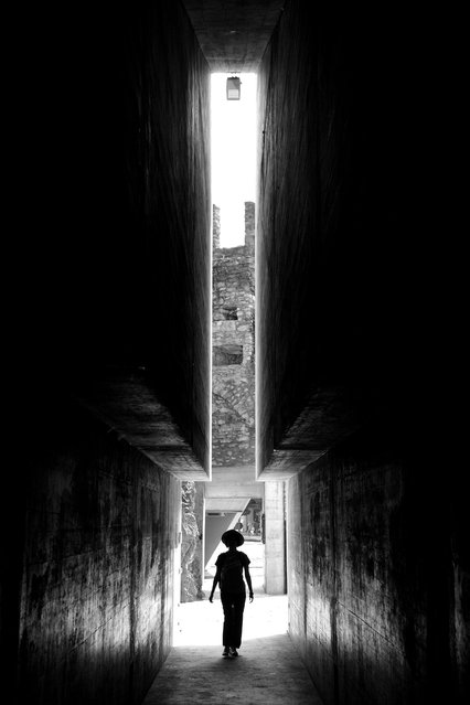 """""""The entrance of the castle"""". I was visiting Castlegrande in Bellinzona, Switzerland, and when I entered the castle, I had a chance to look back and captured the moment my partner just walked into the tunnel of the castle. I was amazed at the unique structure of the tunnel entrance and the mysterious atmosphere created by the light shedding from behind. (Photo and caption by Po Chun Hsu/National Geographic Traveler Photo Contest)"""