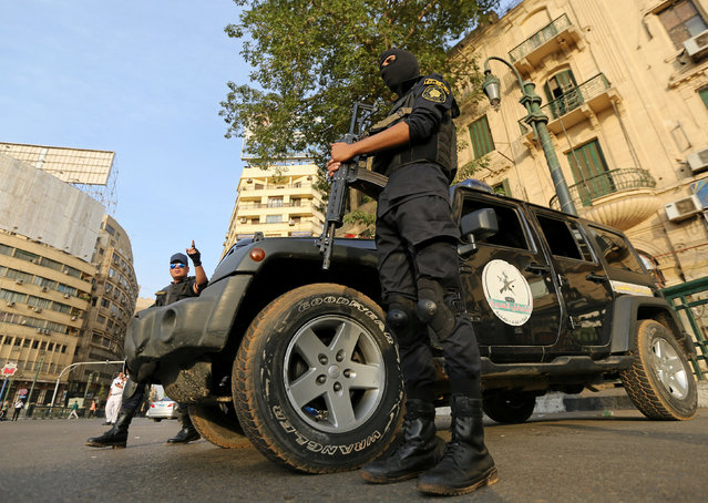 """Members of security forces secure Tahrir Square in Cairo, Egypt, November 11, 2016. Egypt imposed a big security clampdown in its cities on Friday as mass demonstrations called to protest against austerity measures failed to take place. Riot police and armored vehicles filled the otherwise empty streets of central Cairo, but most people stayed at home. President Abdel Fattah al-Sisi has urged Egyptians not to protest and warned that there would be no going back on economic reforms, no matter how much pain they might cause. In a boost for the government, the International Monetary Fund's executive board approved a three-year, $12 billion loan to Egypt aimed at supporting the reforms, and the central bank said it received a first tranche of $2.75 billion. A little-known group calling itself Movement of the Poor had called for Egyptians to protest on Nov. 11 against deepening austerity measures the government says are required to save the Arab world's most populous nation from financial ruin. But big protests failed to materialize across the country by 8:30 p.m (18:30 GMT). Police dispersed several small gatherings and there were some minor clashes. No one was killed or injured. """"The Egyptian people chose stability and development and rejected any calls against that"""", state television quoted Prime Minister Sherif Ismail as saying. The calls to protest began in August, but gained traction on social media last week after Egypt raised fuel prices and floated its currency – a move welcomed by bankers but condemned by ordinary people as the latest blow to their diminishing spending power. (Photo by Mohamed Abd El Ghany/Reuters)"""