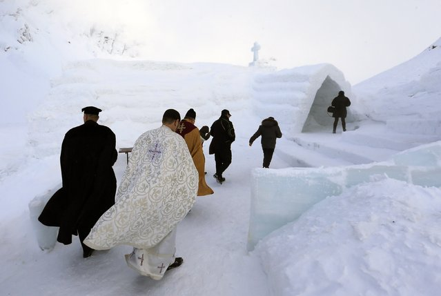 A group of priests of various congregations arrive for the inauguration of a church made entirely from ice at Balea Lac resort in the Fagaras mountains January 29, 2015. (Photo by Radu Sigheti/Reuters)