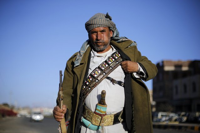 A Houthi fighter secures a street near a gathering for followers of the Houthi movement in Sanaa January 30, 2015. The Houthis have emerged as the dominant faction in Yemen after seizing Sanaa in September. (Photo by Khaled Abdullah/Reuters)