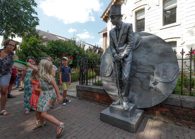 "An artist called ""Le Gouverneur"" takes part in the festival ""Statues en Marche"" in Marche-en-Famenne, Belgium, July 22, 2018. (Photo by Yves Herman/Reuters)"