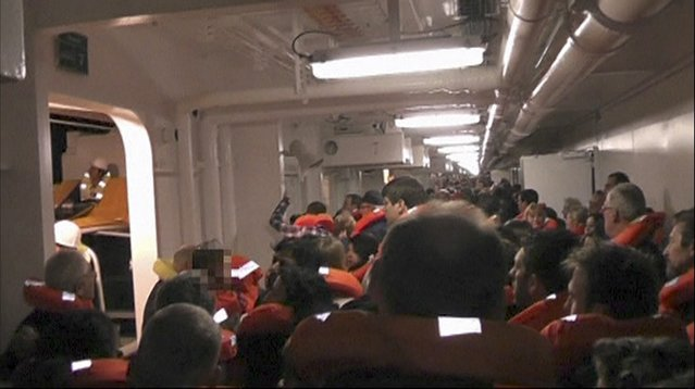 Passengers put on life vests along the corridors of the Costa Concordia cruise ship January 13, 2012 near Giglio, Italy, in this still image taken from an amateur video shot by a German passenger and obtained in this January 14, 2012 file photo. (Photo by Reuters/Amateur Video via Reuters TV)