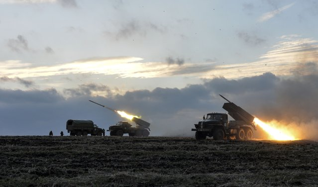 Ukrainian servicemen launch Grad rockets towards pro-Russian separatist forces outside Debaltseve, eastern Ukraine February 8, 2015. Nine Ukrainian soldiers have been killed and 26 wounded in fighting with Russian-backed separatists in Ukraine's eastern regions in the past 24 hours, a Kiev military spokesman said on Monday. (Photo by Alexei Chernyshev/Reuters)
