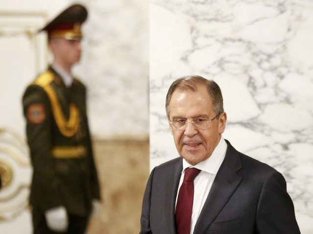 Russia's Foreign Minister Sergei Lavrov (R) walks as he attends a peace summit to resolve the Ukrainian crisis in Minsk, February 12, 2015. (Photo by Vasily Fedosenko/Reuters)