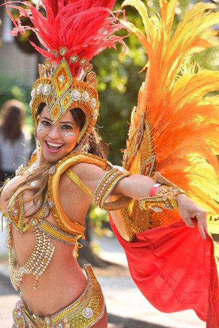 Performers, revellers and carnival goers enjoy the annual Notting Hill Carnival in London, Britain on August 27, 2018. (Photo by Yui Mok/PA Images via Getty Images)