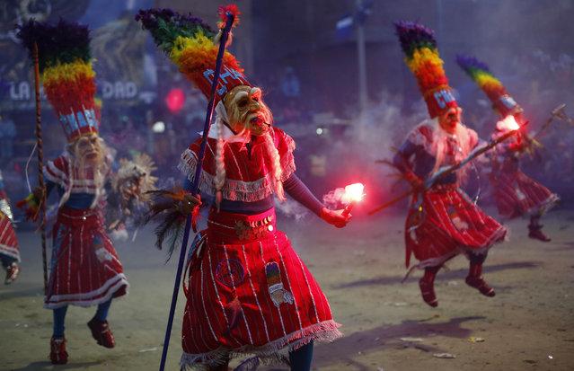 Thobas dancers perform during the carnival celebrations in Oruro, Bolivia, Saturday February 14, 2015. (Photo by Juan Karita/AP Photo)