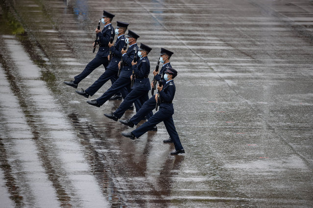 Hong Kong Police officers march in the Chinese-style for the first time in public during an open day to celebrate National Security Education Day at the Hong Kong Police College in Hong Kong, China, 15 April 2021. The former British colony is celebrating its first National Security Education Day after implementation of the Hong Kong National Security Law in June 2020. (Photo by Jerome Favre/EPA/EFE)