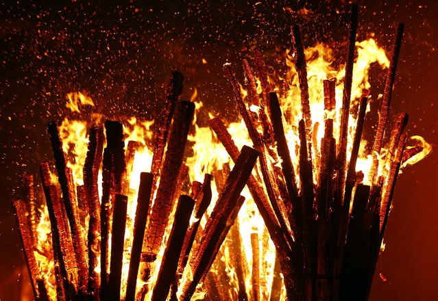Burning wooden sticks of carnival revellers are seen during the traditional Swiss Chienbaese celebration in Liestal near Basel February 22, 2015. (Photo by Ruben Sprich/Reuters)