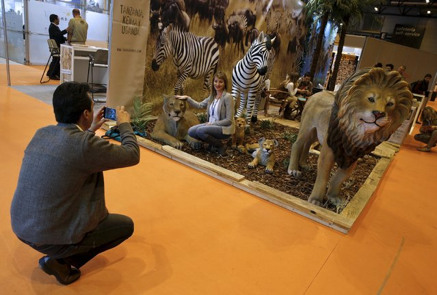 A woman has her picture taken in the Africa area at the FITUR international tourism trade fair which opened in Madrid, Spain, January 20, 2016. (Photo by Andrea Comas/Reuters)