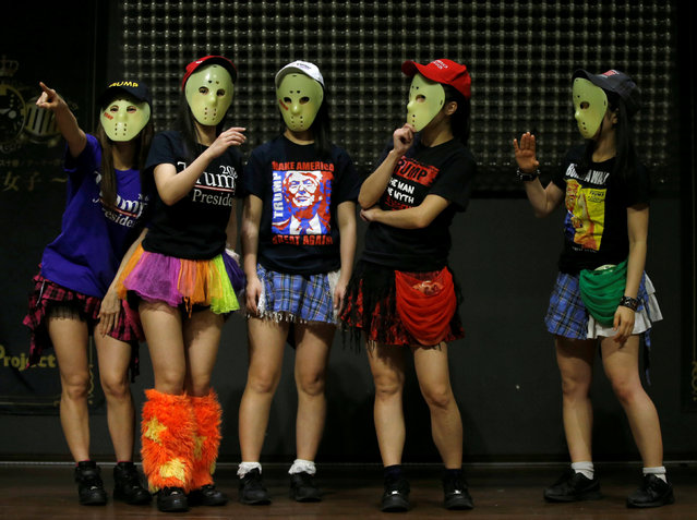 Members of Japanese idol group Kamen Joshi (Masked Girls) in attires featuring images or names of U.S. President-elect Donald Trump, attend a rehearsal for a concert at their theatre in Tokyo's Akihabara district, Japan, December 12, 2016. (Photo by Toru Hanai/Reuters)