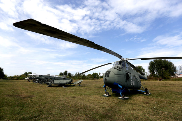 A Mi-4 helicopter is pictured in Kucova Air Base in Kucova, Albania on October 3, 2018. (Photo by Florion Goga/Reuters)