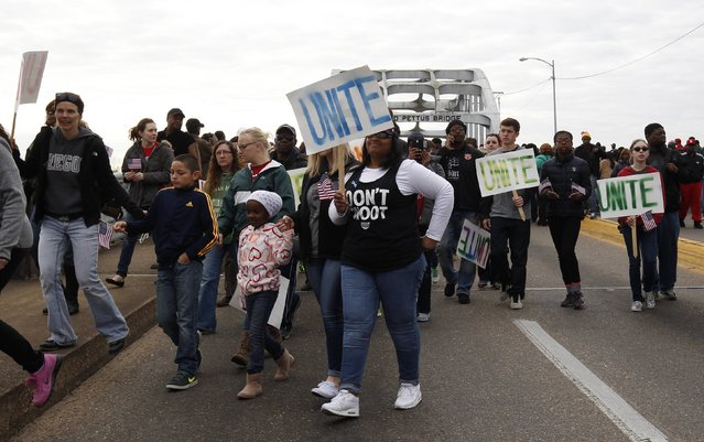 "Students from ""Students Unite"" and other people walk along the Edmund Pettus Bridge before the beginning of the 50th anniversary of the Selma to Montgomery civil rights march in Selma, Alabama March 8, 2015. REUTERS/Tami Chappell  (UNITED STATES - Tags: POLITICS ANNIVERSARY SOCIETY)"
