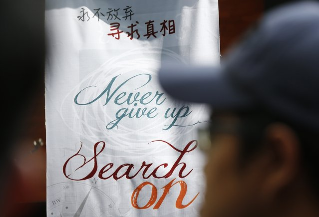 A view of a sign at a remembrance event for missing Malaysia Airlines flight MH370 on the one year anniversary of MH370's disappearance, in Kuala Lumpur, March 8, 2015. Malaysia's Prime Minister Najib Razak said on Sunday Malaysia remains committed to the search for the missing MH370 jetliner a year after it vanished without trace and he is hopeful it will be found. REUTERS/Olivia Harris (MALAYSIA - Tags: TRANSPORT DISASTER ANNIVERSARY)