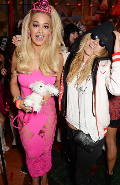 """Rita Ora (L) and Kate Moss dressed as Cara Delevingne attend """"Death Of A Geisha"""" hosted by Fran Cutler and Cafe KaiZen with Grey Goose on October 31, 2014 in London, England. (Photo by David M. Benett/Getty Images)"""