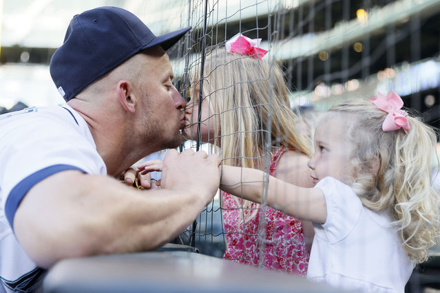 Kyle Seager #15 of the Seattle Mariners kisses his daughter Audrey before the game against the Oakland Athletics during Lou Gehrig Day at T-Mobile Park on June 02, 2021 in Seattle, Washington. (Photo by Steph Chambers/Getty Images)