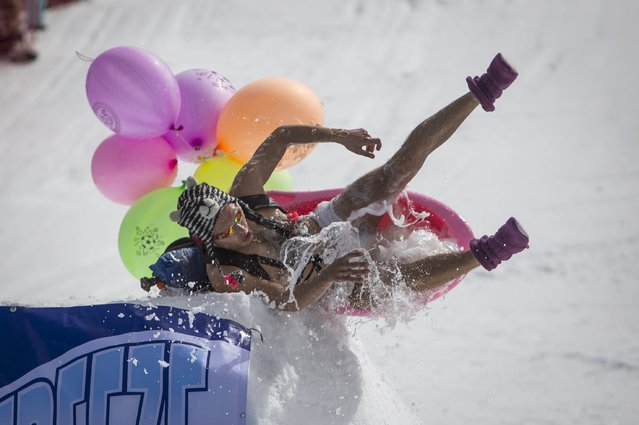 A man slides in a wash-basin as he performs during the Red Bull Jump and Freeze competition at ski resort Shimbulak outside Almaty March 22, 2015. (Photo by Shamil Zhumatov/Reuters)