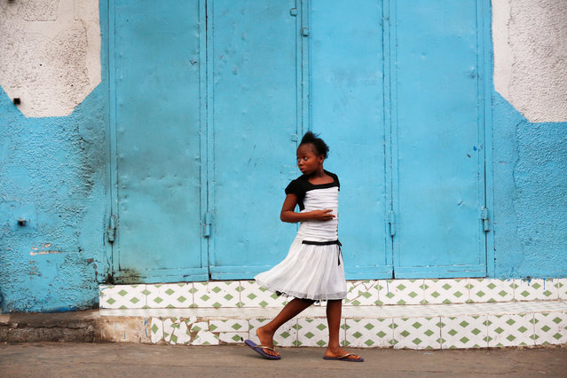 LIBERIA: A girl walks in front of a closed shop in Monrovia, Liberia, July 5, 2016. (Photo by Thierry Gouegnon/Reuters)