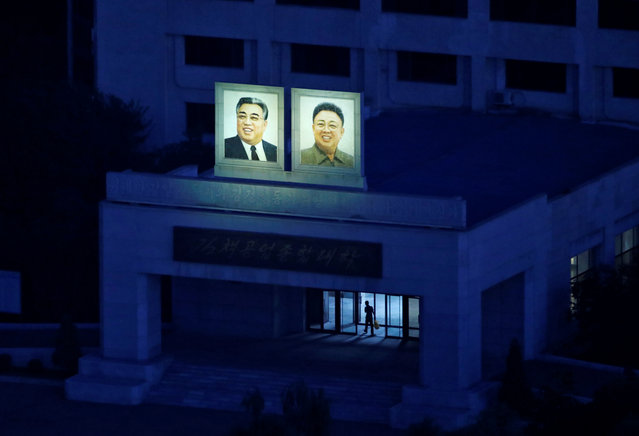 Portraits of late North Korean leaders Kim Il Sung and Kim Jong Il are seen on the facade of a building at Kim Chaek University of Technology pre-dawn in Pyongyang, North Korea, September 8, 2018. (Photo by Danish Siddiqui/Reuters)