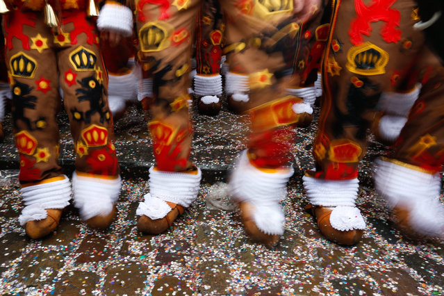 Participants known as Gilles wear traditional costumes during the carnival in the streets of Binche, Belgium, 09 February 2016. The Carnival de Binche has been proclaimed as a Masterpiece of the Oral and Intangible Heritage of Humanity listed by UNESCO for ten years now. (Photo by Laurent Dubrule/EPA)