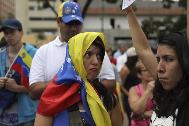 Members of the opposition gather to propose amnesty laws for police and military, in Las Mercedes neighborhood of Caracas, Venezuela, Saturday, January 29, 2019. (Photo by Rodrigo Abd/AP Photo)