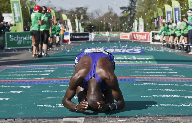 Mark Korir of Kenya kisses the ground after winning the 39th Paris Marathon men's race, Sunday, April 12, 2015. Korir finished the men's race in 2 hours, 5 minutes, 49 seconds. (Photo by Michel Euler/AP Photo)