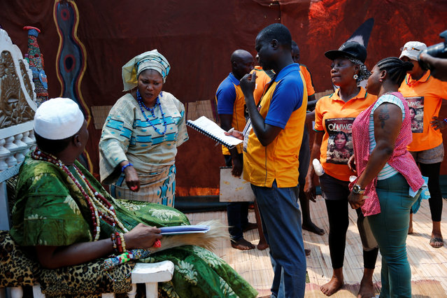 """Cast and crew members rehearse a scene from a script for the film """"Oluwo"""" at a film location in Ilase village, 125km outside Nigeria's commercial capital Lagos, January 16, 2017. (Photo by Akintunde Akinleye/Reuters)"""