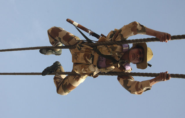 A female recruit from the Indo-Tibetan Border Police (ITBP) takes part in a training session in an ITBP training centre at Bhanu, Haryana, January 27, 2010. (Photo by Ajay Verma/Reuters)