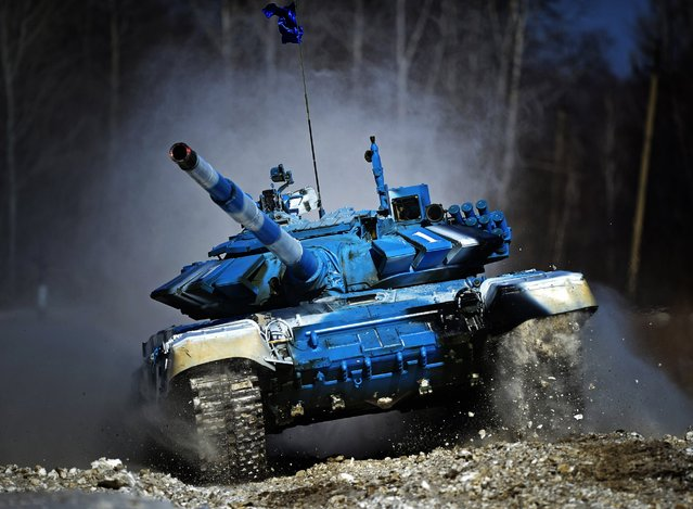 A tank crew competes in an individual race at a regional stage of the 2016 Tank Biathlon Competition at the Anastasyevsky training ground, March 1, 2016, Khabarovsk Territory, Russia. (Photo by Yuri Smityuk/TASS/Newscom)