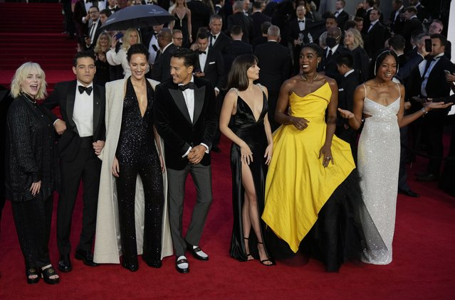 """Billie Eilish, from left, Rami Malek, Phoebe Waller-Bridge, Cary Joji Fukunaga, Ana de Armas, Lashana Lynch and Naomie Harris pose for photographers upon arrival for the World premiere of the new film from the James Bond franchise """"No Time To Die"""", in London Tuesday, September 28, 2021. (Photo by Matt Dunham/AP Photo)"""