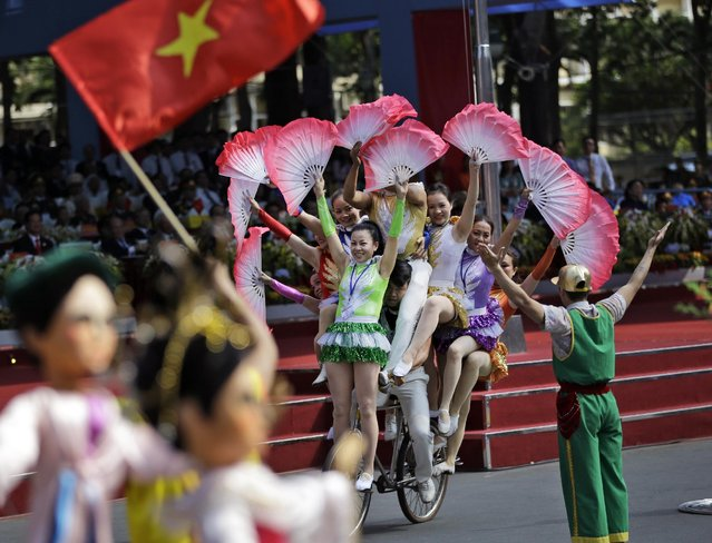 Performers show their skills during a parade celebrating the 40th anniversary of the end of the Vietnam War which is also remembered as the fall of Saigon, in Ho Chi Minh City, Vietnam, Thursday, April 30, 2015. (Photo by Dita Alangkara/AP Photo)