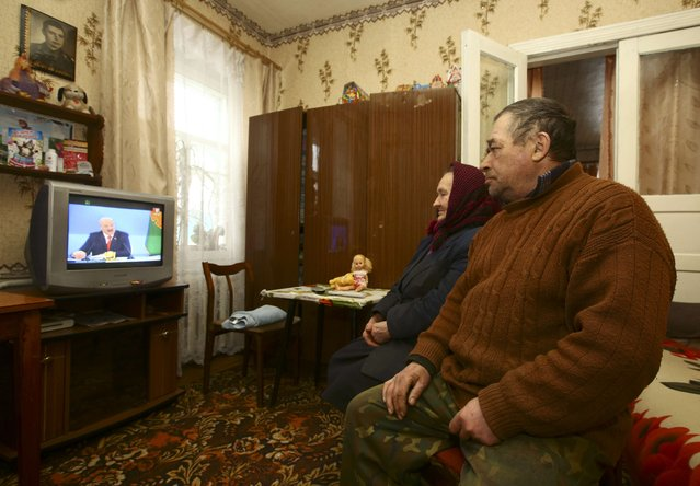 Local residents watch a live broadcast of a news conference of Belarus' President Alexander Lukashenko at their house in the village of Khrapkov, Belarus February 3, 2017. (Photo by Vasily Fedosenko/Reuters)