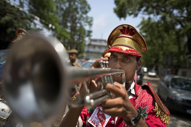 A member of a brass band plays an instrument during a rally to mark May Day in Gauhati, India, Friday, May 1, 2015. May 1 is celebrated as the International Labor Day or May Day across the world. (Photo by Anupam Nath/AP Photo)