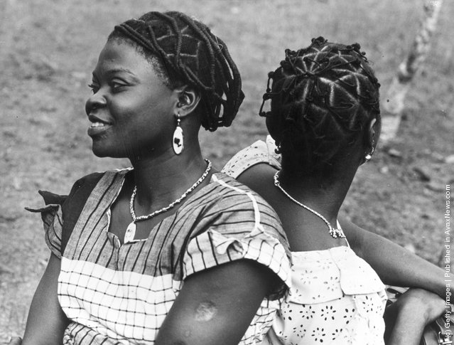 11th February 1956:  Nigerian women from Ksukka with intricately coiffured hair which they have styled in honour of the visit of Queen Elizabeth II