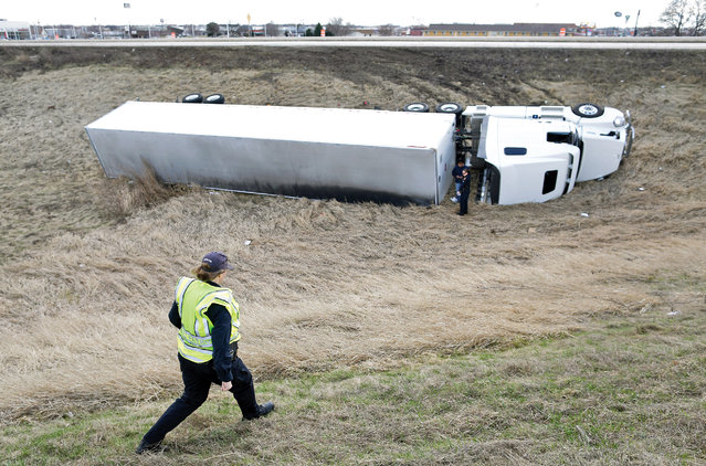 A semi-trailer lays on it's side near the Interstate 90/39 north onramp on the north side of Janesville, Wis., on Wednesday, March 16. High winds Wednesday led to downed trees and wires, a lack of flights in and out of Southern Wisconsin Regional Airport and at least one semi-trailer tipped over. (Photo by Anthony Wahl/The Janesville Gazette via AP Photo)