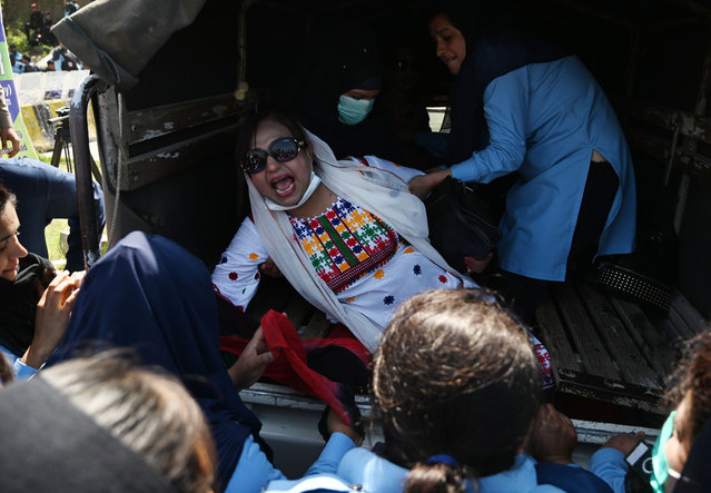 Pakistani policewomen arrest a supporter of Pakistan Peoples Party (PPP) outside the accountability court at the arrival of former Pakistani president Asif Ali Zardari and his sister Faryal Talpur to face charges of money laundering case in Islamabad on April 8, 2019. Former Pakistani president and co-chairperson of Pakistan Peoples Party (PPP) Asif Ali Zardari and his sister Faryal Talpur appeared on April 8 before the accountability court in Islamabad on charges of money laundering through fake accounts. (Photo by Aamir Qureshi/AFP Photo)
