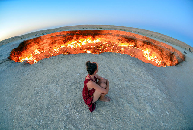 Ben Southall's wife, Sophee, takes a moment in Turkmenistan . (Photo by Ben Southall/Caters News Agency)