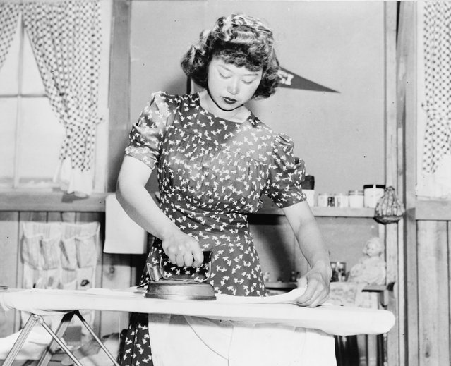 Ester Naite, an office worker from Los Angeles, is shown operating an electric iron in her quarters at the Manzanar War Relocation Center in California, in this April - July 1942 handout photo. (Photo by Courtesy Dorothea Lange/Farm Security Administration and Office of War Information Collection/Library of Congress/Reuters)
