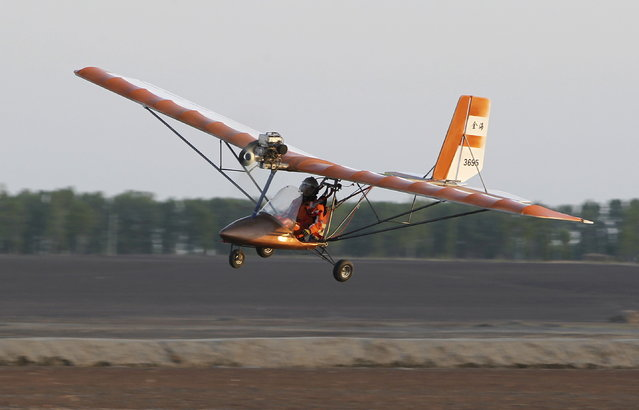 Yang Shijun, 45-year-old manager of a construction material company, flies his homemade plane during a test run in Changchun, Jilin province, China, May 9, 2015. Yang spent almost 100,000 yuan (16,098 USD) and over one year to make the 5-metre-long, 9.5-metre-wide plane, as a tribute to his father, who passed away in 2011 and had been a pilot for 29 years, local media reported. (Photo by Reuters/Stringer)