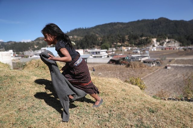 A girl, who's father works as as immigrant laborer in the U.S. plays in Cajola on February 11, 2017 in the western highlands of Guatemala. (Photo by John Moore/Getty Images)