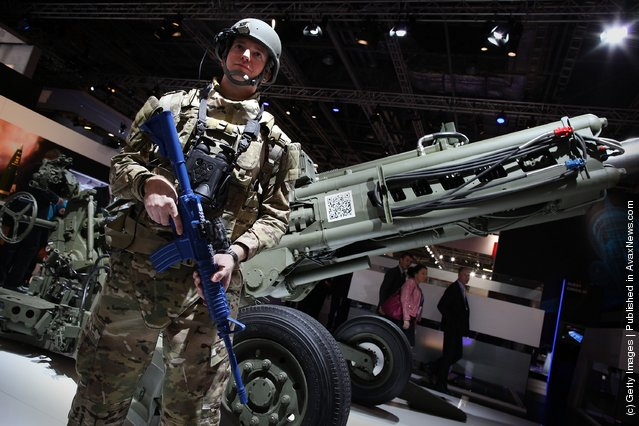 A soldier displays new technology at The Defence and Security Exhibition