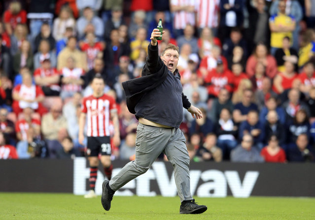A fan runs on the pitch during the English Premier Leagues soccer match between Southampton and Huddersfield at St Mary's Stadium, Southampton, England, Sunday, May 12, 2019. (Photo by Adam Davy/PA Wire via AP Photo)