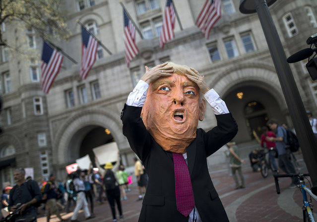 An actor portraying US President Donald J. Trump calls on the President to release his tax returns outside the Trump Hotel in Washington, DC, USA, 15 April 2017. (Photo by Jim Lo Scalzo/EPA)